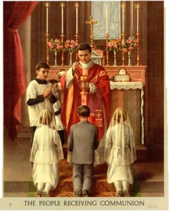 Enkele kinderen ontvangen de H. Communie tijdens de Mis